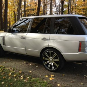 "Silver Range Rover SC with 22"" Stormers"